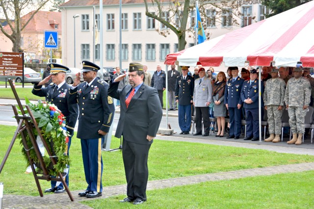 Col. David Carstens, U.S. Army Garrison Wiesbader commander, Command Sgt. Maj. Sa'eed Mustafa and James Mann, commander of Veterans of Foreign Wars Post 27, salute during a Veterans Day ceremony on Wiesbaden's Clay Kaserne Nov. 7.