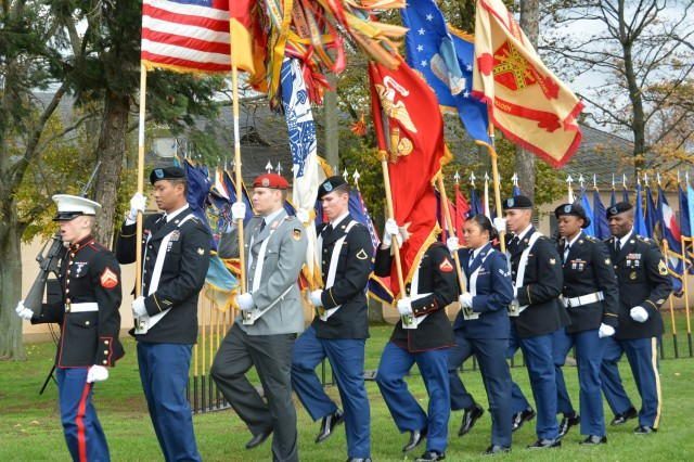 Members of the color guard present the colors during the Veterans Day ceremony on Wiesbaden's Clay Kaserne.
