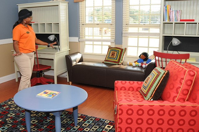 Sasha LaForge, supervising program specialist for the CDC, showcases the sitting and reading area in the Mini CDC Nov. 12. The Mini CDC will have its grand opening ceremony Nov. 15 at 3 p.m.