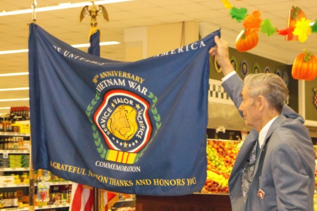 Vietnam veterans saluted with flag unveiling at commissary