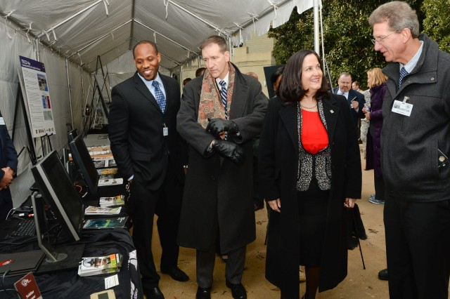Katherine Hammack (second from right), assistant secretary of the Army for Installations, Energy and Environment, talks with Ed Plichta (far right), chief of the Power Division within CERDEC's Command, Power and Integration Directorate, in the Pentagon Courtyard Nov. 14.