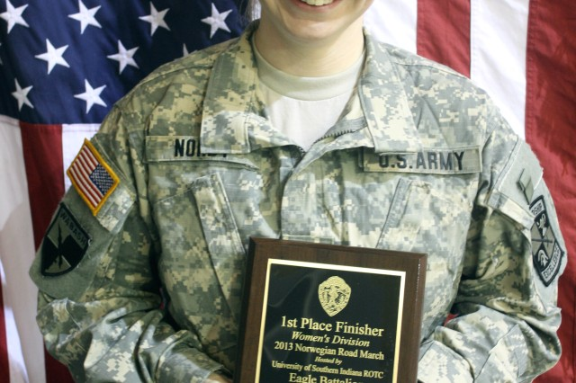 Emily Nordt, an Army ROTC Cadet from Rose-Hulman Institute of Technology, displays the plaque she earned for first place in the female category at the University of Southern Indiana's 12th Annual Norwegian Foot March, recently.