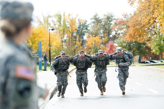Participants use teamwork while competing in the University of Southern Indiana's 12th Annual Norwegian Foot March.