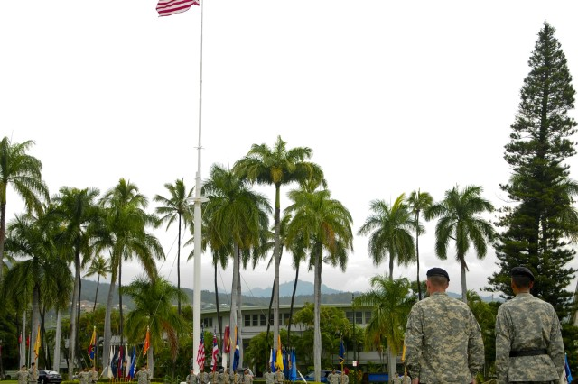"""FORT SHAFTER, Hawaii """" General Vincent K. Brooks, U.S. Army, Pacific commanding general (right) and Col. (promotable) Robert Ulses, the new assistant chief of staff for the U.S. Army Pacific survey historic Palm Circle during a Flying V welcoming ceremony held at Palm Circle, Nov. 15. A Flying V is named after the V shape in which the colors are posted during the ceremony. (U.S. Army Photo by Staff Sgt. Kyle J. Richardson, USARPAC PAO)."""