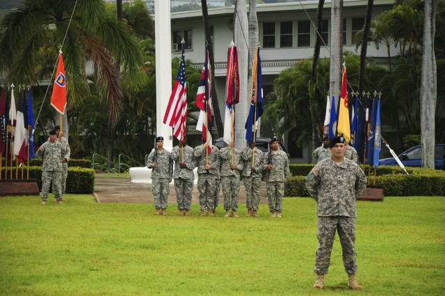 """FORT SHAFTER, Hawaii """" Col. Michael Anastasia, the commander for the troops, stands at parade rest with the troops during a Flying V welcoming ceremony held at Palm Circle, Nov. 15. Col. Robert Ulses, the new assistant chief of staff for the U.S. Army Pacific was welcomed during the morning's ceremony. (U.S. Army Photo by Staff Sgt. Kyle J. Richardson, USARPAC PAO)."""