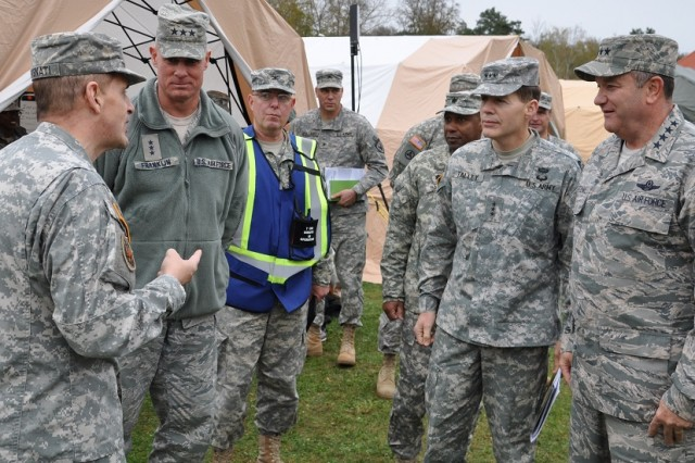 Brig. Gen. Paul Benenati (left), commanding general of the 7th Civil Support Command (CSC), speaks with Lt. Gen. Craig Franklin, commander, 3rd Air Force and 17th Expeditionary Air Force; Lt. Gen. Jeffrey Talley, commanding general of the U.S. Army Reserve Command; and Gen. Philip Breedlove, commander, U.S. European Command and Supreme Allied Commander, Europe, during a demonstration of the commands foreign consequence management capabilities in Kaiserslautern, Germany.  Army Reserve Soldiers serving with the 7th CSC are capable of providing assistance to a requesting Host Nation, upon request by the Department of State, to mitigate the effects of a deliberate or inadvertent chemical, biological, radiological, or nuclear attack or event, and to restore essential operations and services. (U.S. Army photo by Maj. Meritt Phillips/released)