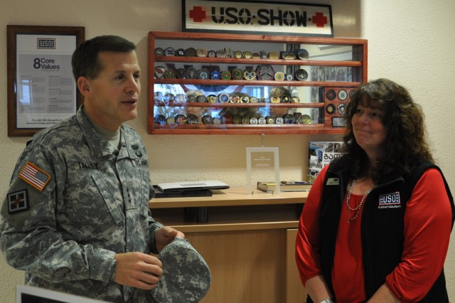 Lt. Gen. Jeffrey Talley, commander of U.S. Army Reserve Command pauses for a photo after placing a coin on the shelf of the United Service Organization's Warrior Center in Landstuhl, Germany, during a visit Nov. 6. Dawn Rysavy, the center's manager, provided a location for Talley to meet with ill and injured Army Reserve Soldiers currently receiving medical care at the adjacent medical facility. (U.S. Army photo by Maj. Meritt Phillips/released)