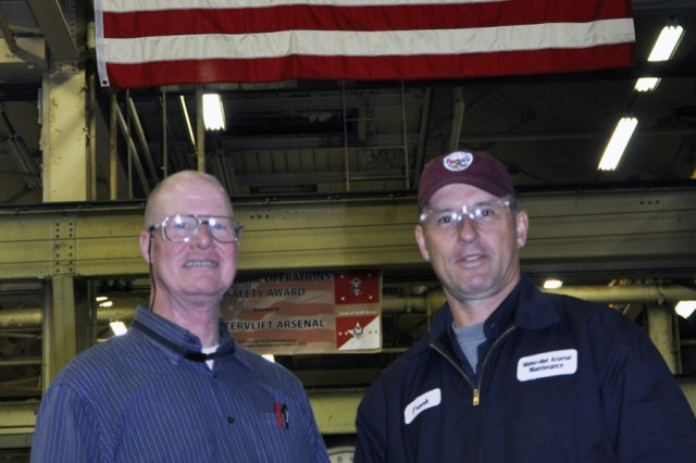 Robert Jensen, left, manages the 27-person team who keep the more than 600 manufacturing machines in operation.  Jensen takes great pride in the expertise that his team provides, from those who have more than 38 years of experience, to Frank Masterson, r, who has been with the arsenal for about one year.  Masterson retired from the U.S. Marine Corps before joining the arsenal.