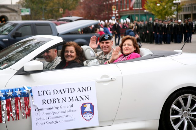 U.S. Army Space and Missile Defense Command/Army Forces Strategic Command commanding general Lt. Gen. David L. Mann and his wife, Robyn, join the residents of Athens, Ala., in their Veterans Day parade Nov. 9.