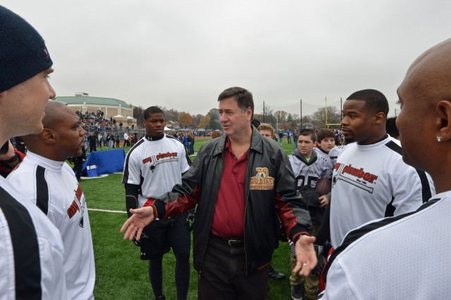Former Virginia Gov. George Allen, in the tradition of his late father who coached the Washington Redskins for six years, coaches the Washington Redskins Alumni Team in a challenge against the Wounded Warrior Amputee Football Team, which played a flag football game at Bishop O'Connel High School in Arlington, Va., Nov. 16, 2013, as part of Warrior Care Month. Sponsored by the non-profit Military Benefit Association, $60,000 was raised for the amputees. While the gridiron battle's outcome came down to the final seconds, the amputees won out 28-21.