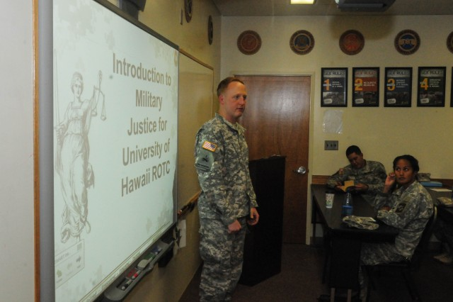 "HONOLULU, Hawaii "" Maj Nathan Jacobs, Judge Advocate for 2nd Stryker Brigade Combat Team, 25th Infantry Division, instructs University of Hawaii "" Manoa Reserve Officer Training Corps cadets in Military Justice and Law of War. Jacobs was invited to be a guest lecturer by Maj. John Carson, UH-Manoa's Professor of Military Science and former executive officer at 1st Battalion, 14th Infantry Regiment, 2nd SBCT. (U.S. Army photo by Staff Sgt. Sean Everette)"
