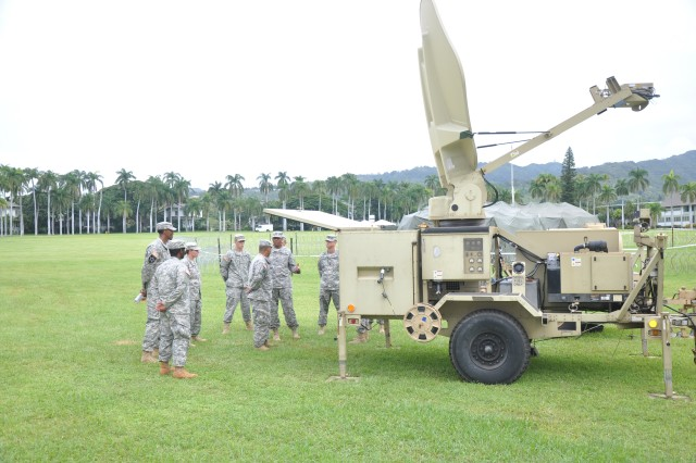 Several Soldiers with the Contingency Command Post team participate in a walk-through of communications equipment used during mission operations. The Soldiers demonstrated their capabilities at Palm Circle, Nov. 14, 2013, at Fort Shafter, Hawaii.