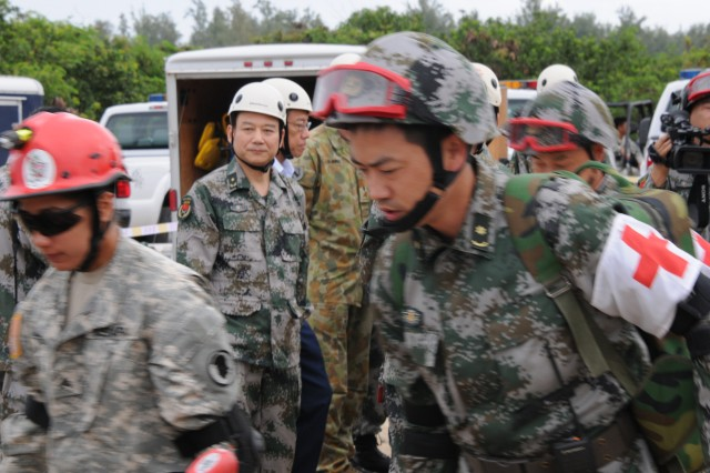 Senior officials observe the Practical Field Exchange during the 9th annual Disaster Management Exchange. The DME provided an opportunity for both armies to demonstrate and discuss their different approaches to a humanitarian assistance and disaster relief scenario. The DME allows both countries to be better prepared to respond to a third country in the event of a major natural disaster. This year's DME consisted of an Expert Academic Discussion and a Practical Field Exchange.