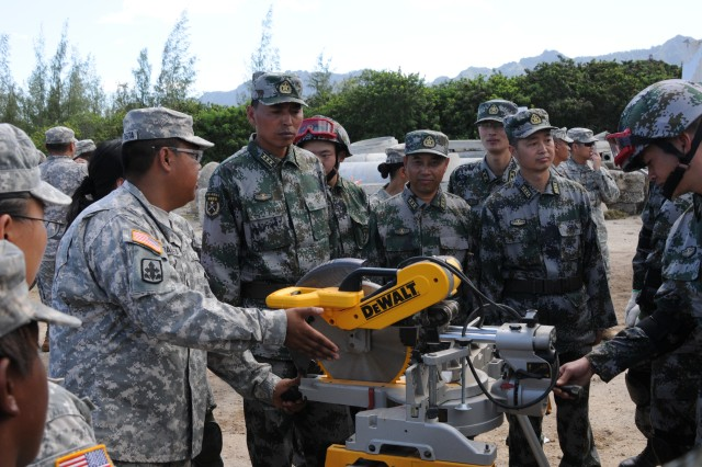 Sgt. Jonathon Bautista from the Hawaii Army National Guard demonstrates equipment to the People's Liberation Army soldier's during Disaster Management Exchange  Nov. 14. Soldiers from United States Army Pacific, Hawaii Army National Guard and Army Corps of Engineers along with representatives from the Federal Emergency Management Agency will participate with the PLA in a DME, Nov. 12 -14 in Hawaii. The 2013 DME is a U.S. Army hosted subject matter expert exchange focused on an international Humanitarian Assistance and Disaster Relief operation. Both US and PLA demonstrate equipment used during HA/DR operations.