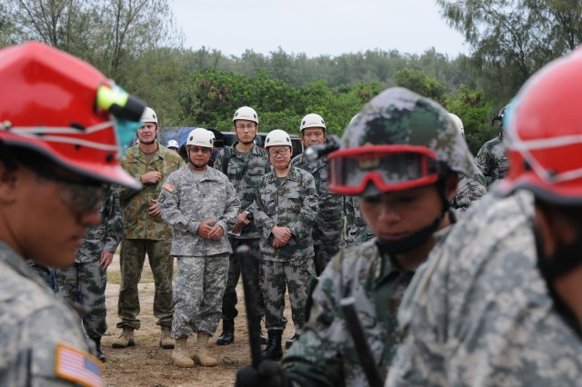 U.S. Army Pacific Deputy Commanding General for Army National Guard Maj. Gen. Gary Hara, left, Peoples Liberation Army Deputy Political Commissar of Chengdu Military Region Lt. Gen. Zhao, second from left, U.S. Army Pacific Deputy Commanding General for Operations Maj. Gen. Rick Burr, and other high ranking officials observe the Practical Field Exchange during the 9th annual Disaster Management Exchange, an opportunity for both armies to demonstrate and discuss their different approaches to a humanitarian assistance and disaster relief scenario. The DME allows both countries to be better prepared to respond to a third country in the event of a major natural disaster.  This year's DME consists of an Expert Academic Discussion and a Practical Field Exchange. Event was held at the Marine Corps Training Area-Bellows, Hawaii
