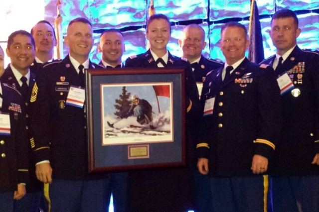 Nine Army Space Soldiers from Headquarters and Headquarters Company, 1st Space Brigade, pose with their award during third annual Military Officers Association of America Community Heroes Award Night Nov. 15 at the Antlers Hilton in Colorado Springs, Colo. Capt. Mallory Kessler, commander of the HHC, is center.