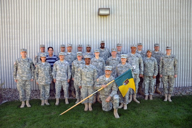 Group shot of Soldiers and civilian with Headquarters And Headquarters Company, 1st Space Brigade. The company was recognized for their volunteer efforts in the Colorado Springs, Colo., community during the third annual Military Officers Association of America Community Heroes Award Night Nov. 15 .