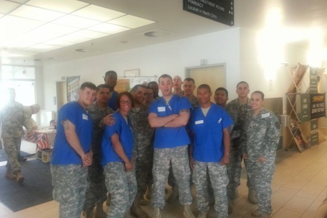 BOSS Soldiers pose for a photo while volunteering as dental assistants at the garrison Retirement Day, recently.