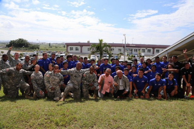 Toyota Industries Shuttles Rugby Team, soldiers from the 10th Regional Support Group and Yomitan Village Officials having fun taking a photo after a friendship luncheon on Torii Station on Nov. 7. Approximately 40 players from the Shuttles visited Torii Station during their training camp on Okinawa to enhance bilateral relationships between the U.S. soldiers, family members as well as American and Japanese employees through sporting initiatives like rugby.