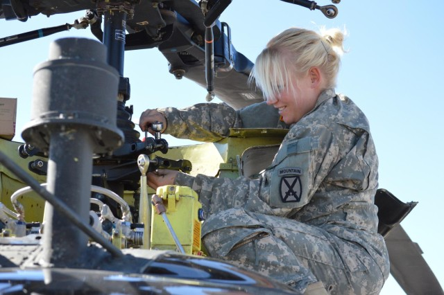 Pfc. Kayla Cole, an OH-58D Kiowa helicopter repairer with Troop C, 6th Squadron, 6 Cavalry, originally from Piedmont, Mo., performs a uniball friction check during progressive phase maintenance at McGregor Range Complex, N.M., Nov. 9, 2013. The cavalry unit provided aerial support to ground units while evaluating air-to-ground radio communication equipment as part of Network Integration Evaluation 14.1. (Photo by Staff Sgt. Candice Harrison, 24th Press Camp Headquarters, Fort Bliss, Texas)
