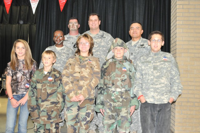"Soldiers from the 120th Infantry Brigade, Division West take a group photo with the Gatesville Intermediate School Students during the ""Say No with Camo!"" day, Oct. 30 in Gatesville, Texas. (Photo by Capt. Soutira Graham, 120th Infantry Brigade, Division West Public Affairs)"