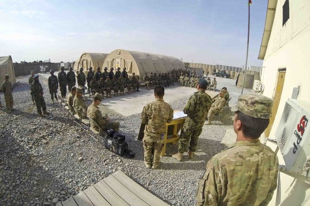 FORWARD OPERATING BASE AZIZULLAH, Afghanistan -- U.S. Army Troopers and leaders with 3rd Squadron, Combined Task Force Dragoon, Afghan National Army and Afghan National Civil Order Police, attend a transfer ceremony Nov. 15, 2013, at Forward Operating Base Azizullah, Afghanistan. Troopers with 3rd Squadron relinquished authority over the base to the ANA and ANCOP in support of Operation Enduring Freedom.
