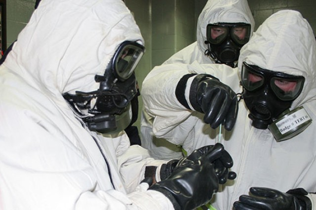 Emergency responders in a training course, sample for the possible detection of the biological material ricin.