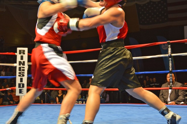Mainz-Kastel's Monika Schweiz trades blows with Wiesbaden's Lisa Manela during their 125-pound featherweight bout.