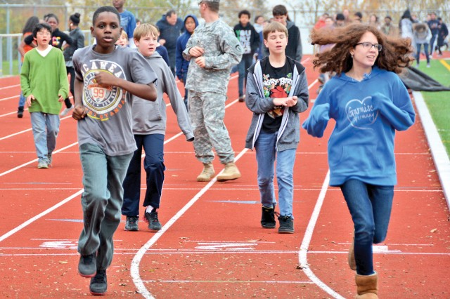 U.S. Army Europe Soldiers join Wiesbaden Middle School students and teachers for a run during this year's Fueling the Future launch Nov. 15.
