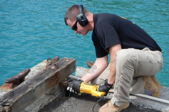 More than a dozen soldiers from the 7th Engineer Dive Detachment, 130th Engineer Brigade and construction contractors from Sea Engineering Inc. conducted underwater repairs, Nov. 4-22, to the tsunami damage at Keauhou Small Boat Harbor. For the 7th Engineer Dive Detachment, this was an opportunity for the divers to train and remain proficient on one of their wartime missions: performing port construction and the rehabilitation of waterfront facilities. For those who use the harbor, it provides added safety after the March 11, 2011, tsunami.
