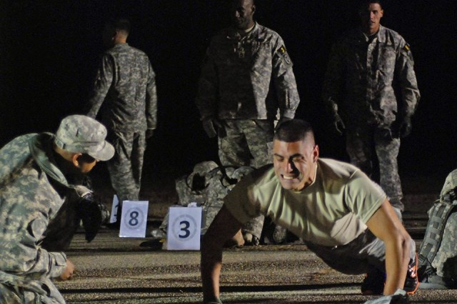 Sgt. Anthony Calvi, the NCO of the Year competitor from the Army National Guard, performs push-ups during the first event of the 2013 Army Best Warrior Competition, at Fort Lee, Va., Nov. 20, 2013.