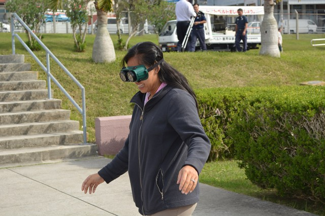 Maintaining your balance while walking and wearing DUI goggles is harder than it looks -- as demonstrated by an employee of the Army Substance Abuse Program during Safety Day on Torii Station on Nov. 21, 2013.