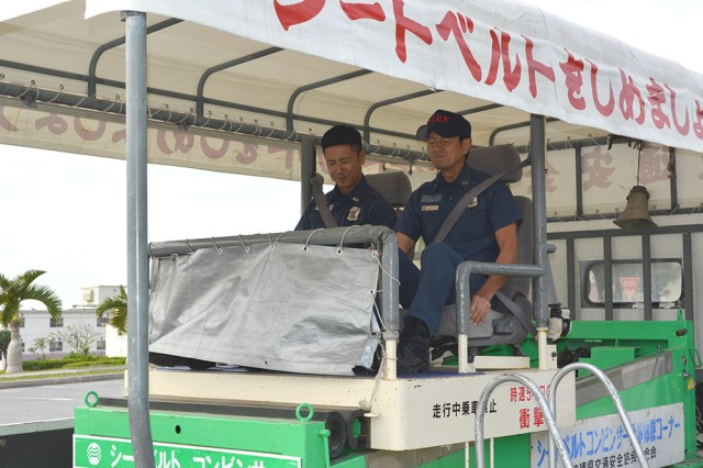 The seat belt convincer demonstrates the importance of wearing a seatbelt -- and how hard an impact is at five kilometers per hour during a Safety Day event on Torii Station on Nov. 21, 2013.