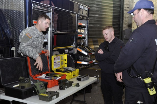 Soldier from New York's 2nd Civil Support Team, Weapons of Mass Destruction, providing radiological training to arsenal firefighters.