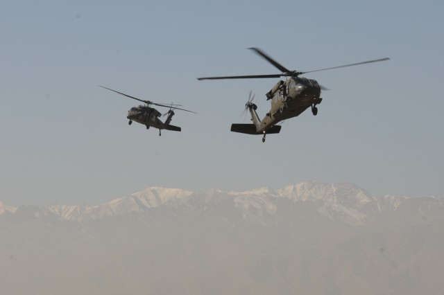 UH-60 Black Hawk helicopters flown by members of 10th Combat Aviation Brigade, return to Bagram Airfield after a mission Nov. 21. (Photo by Staff Sgt. Todd Pouliot, 10th Combat Aviation Brigade)