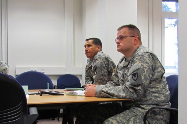 In Grafenwoehr, Germany, Lt. Col. Robert Murray, 928th Contingency Contracting Battalion (left), and Master Sgt. Raymond Padgett, senior enlisted advisor, 928th CCBn receive information on the 3in1 Tool.  (Photo by Sgt. 1st Class, Stephen Phillippi, 409th Contracting Support Brigade)