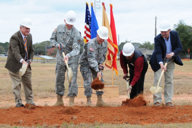 Ed Janasky, Directorate of Public Works director, Col. Stuart J. McRae, Fort Rucker garrison commander, Maj. Gen. Kevin W. Mangum, U.S. Army Aviation Center of Excellence and Fort Rucker commanding general, Jess Lira, Defense Commissary Agency representative, and Ray Boggs, Carothers Construction Inc. representative, take shovels in hand and break ground on the new, state-of-the-art commissary during a ground breaking ceremony at the corner of Ruff Avenue and Division Road Nov. 15.