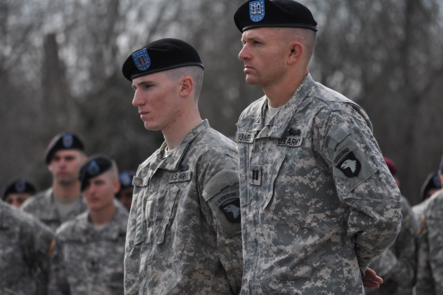 """Capt. Jason Burnes, an assistant operations officer at Headquarters and Headquarters Company, 3rd Special Troops Battalion, 3rd Brigade Combat Team """"Rakkasan"""", 101st Airborne Division (Air Assault) and Pvt. Robert C. Wall, a rifleman from Company A, 1st Battalion, 187th Infantry Regiment, 3rd Brigade Combat Team, 101st Airborne Division (Air Assault) stand in front of the graduating class Nov. 22, 2013 after being awarded the Air Assault Badge.  Burnes set the unofficial record for the 12-mile foot march, a culminating event at the The Sabalauski Air Assault School.  Wall was the class honor graduate."""