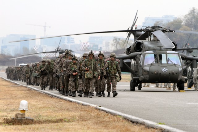 CAMP HUMPHREYS, South Korea- Soldiers of Republic of Koreas 2nd Battalion, 100th Regiment, 17th Infantry Division prepare to board UH-60 Black Hawk helicopters during the largest combined air assault of the year with 2nd (Assault) Battalion, 2nd Aviation Regiment, 2nd Combat Aviation Brigade, 2nd Infantry Division Nov. 14, 2013 at an undisclosed location in South Korea.