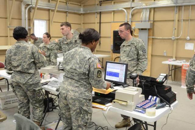 Soldiers from the U.S. Army, Army Reserves and the National Guard work together to set-up and run a mobile post office during a postal class exercise at Silver Scimitar at Fort Devens, Mass., Nov. 13, 2013. Silver Scimitar is the U.S. Army Forces Command's bi-annual, multi-echelon training exercise designed to train Human Resources units scheduled for deployment on core competencies for operations within a deployed area of responsibility. (U.S. Army photo by Sgt. Dianne M. Carter/Released)