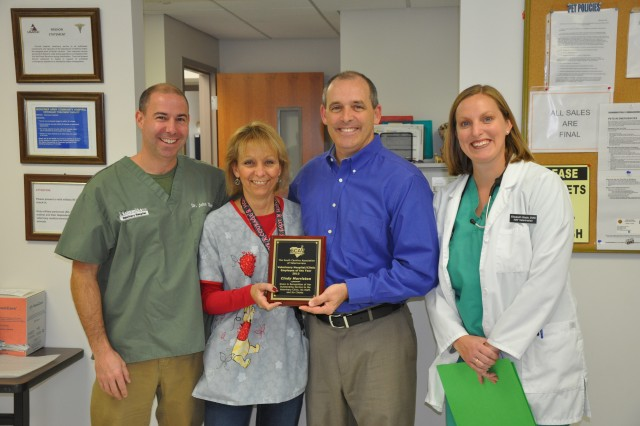 Cindy Morriston, an administrative assistant at the Fort Jackson Veterinary Treatment Facility was recently named Veterinarian Hospital/Clinic Employee of the Year by the S.C. Association of Veterinarians. She was presented the award last week at the clinic. Pictured, from left, are John Thomas, of Sandhills Veterinary Hospital, Morriston, Tim Loonam, of Grace Animal Hospital, and Elizabeth Slade, Fort Jackson veterinarian.