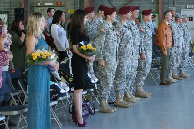 """Soldiers, Families and guests sing the """"Army Song"""" at the conclusion of the activation ceremony for Company E, 160th Special Operations Aviation Regiment (Airborne) Tuesday at Libby Army Airfield."""