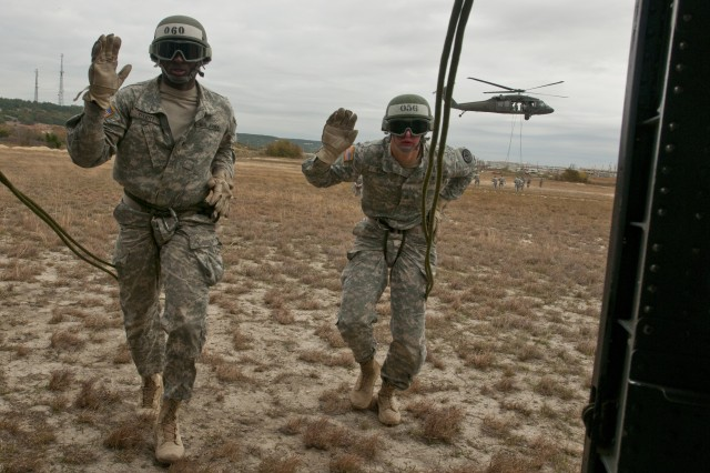 Air Assault School students approach Black Hawk for rappel testing