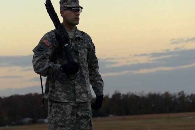Staff Sgt. De Gosh Reed displays precision in handing a weapon in a morning challenge at the Best Warrior Competition at Fort Lee, Va., Nov. 21, 2013.