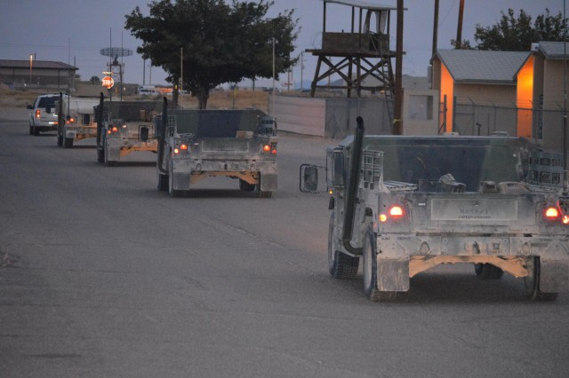 Marines and a Navy corpsman roll out in a convoy to evaluate the Joint Battle Command Platform during Network Integration Evaluation 14.1 at McGregor Range Complex, N.M., Nov. 13, 2013. The service members participated in Network Integration 14.1 at Fort Bliss, Texas, and surrounding training areas. Marine Corps Systems Command coordinated the Marine Corps portion of the testing. (Photo by Staff Sgt. Candice Harrison, 24th Press Camp Headquarters, Fort Bliss, Texas)