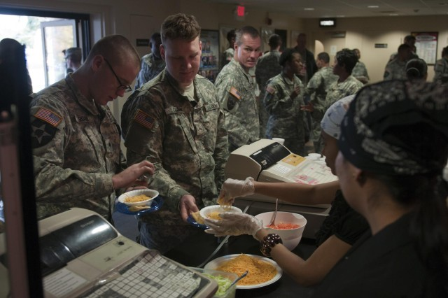Soldiers eat traditional Native American cuisine after a National American Indian Heritage Month observance on Joint Base Lewis-McChord, Wash., Nov. 19.