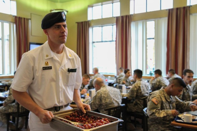 Spc. Curtis W. McFarland, an Alexandria, Va., native, and food service specialist with 606th Forward Support Company, 1st Battalion, 377th Field Artillery Regiment, 17th Fires Brigade, 7th Infantry Division, restocks fruit during the breakfast meal at the Cannon and Castle Grill, Joint Base Lewis McChord, Wash., Nov. 15. McFarland was recently named I Corps Cook of the Year when he won the junior soldier category in the base-wide competition board, Nov. 14. (U.S. Army photo by Spc. Nathan Goodall, 17th Fires Brigade Public Affairs)