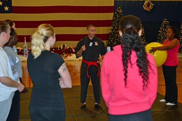 Maj. Luis LopezColon, brigade chaplain, 4th Combat Aviation Brigade, 4th Infantry Division, teaches self-defense tactics to female soldiers and spouses from 4th CAB, at the Special Events Center on Fort Carson, Colo., Nov. 7, 2013. (Photo by Sgt. Jonathan C. Thibault, 4th Combat Aviation Brigade Public Affairs Office, 4th Infantry Division/Released)
