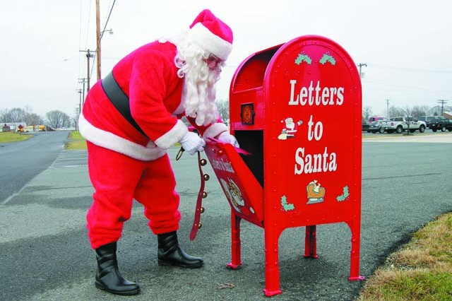 Santa checks the Letters to Santa mailbox next to the Directorate of Emergency Services, Bldg. 2200 Frankford Street, for holiday wishes from Aberdeen Proving Ground children. APG firefighters will collect Letters to Santa through Dec. 20.   File photo