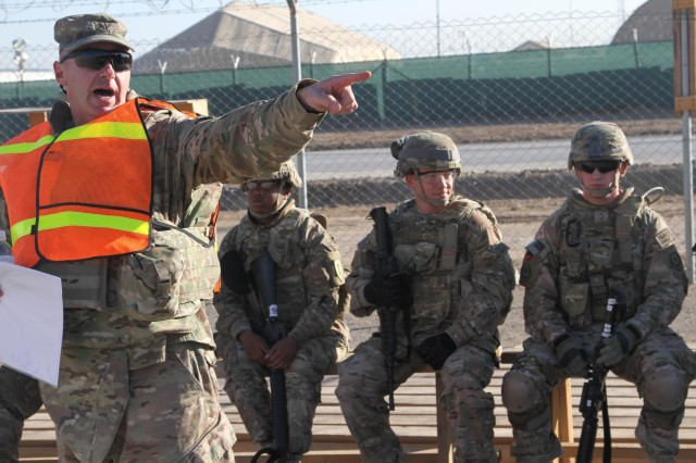 Sgt. First Class Thomas Maia, a range NCOIC with 1st Combat Aviation Brigade, 1st Infantry Division, points while briefing chaplain assistants during a stress training at Kandahar Airfield, Afghanistan, Nov. 19, 2013. (U.S. Army photo by Sgt. Antony S. Lee)